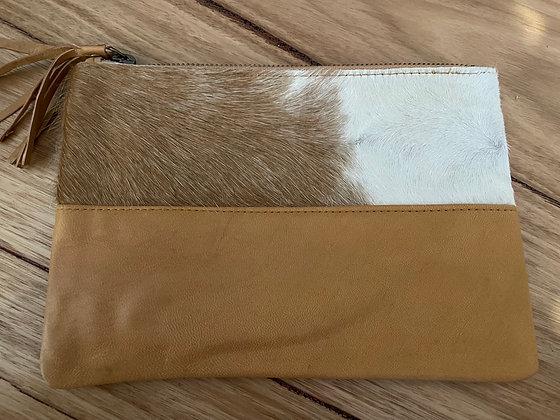 Tan hair upper leather clutch
