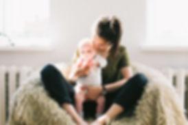 full-time babysitter holds infant