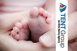Preemie Twins feet held by mother
