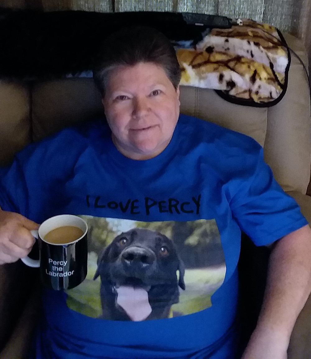 Marlo wearing a Percy the Labrador T-Shirt & holding a Percy the Labrador Mug