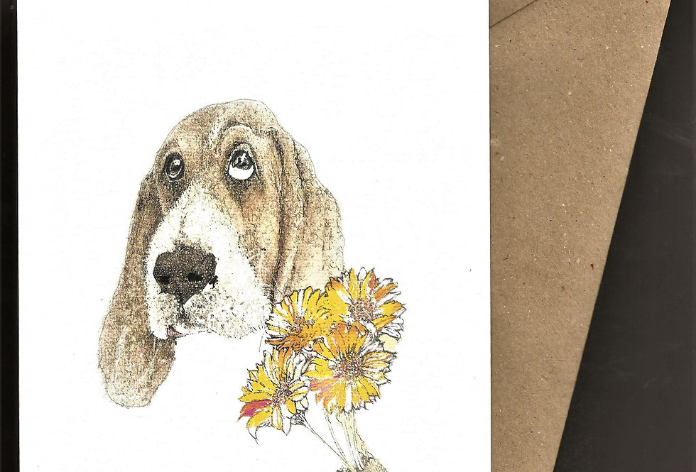 Hound dog with big eyes and a bunch of flowers- pen and ink design by Robert Askew