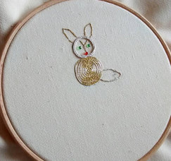 A student's finished Goldwork hoop