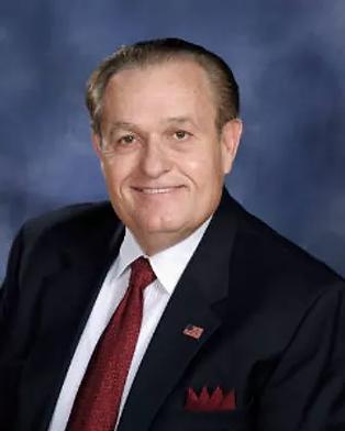 Dr. John Tisdale