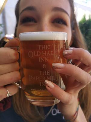 Holly enjoying half an ale!