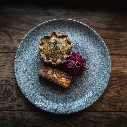 On our pub classics menu for the winter. Game pie, pickled cabbage and dauphinoire potato.
