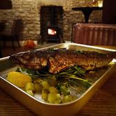 Oven roasted whole mackerel marinated in