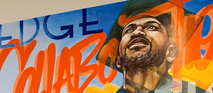 colorful mural from Beyond 12 featuring a graduate looking hopeful