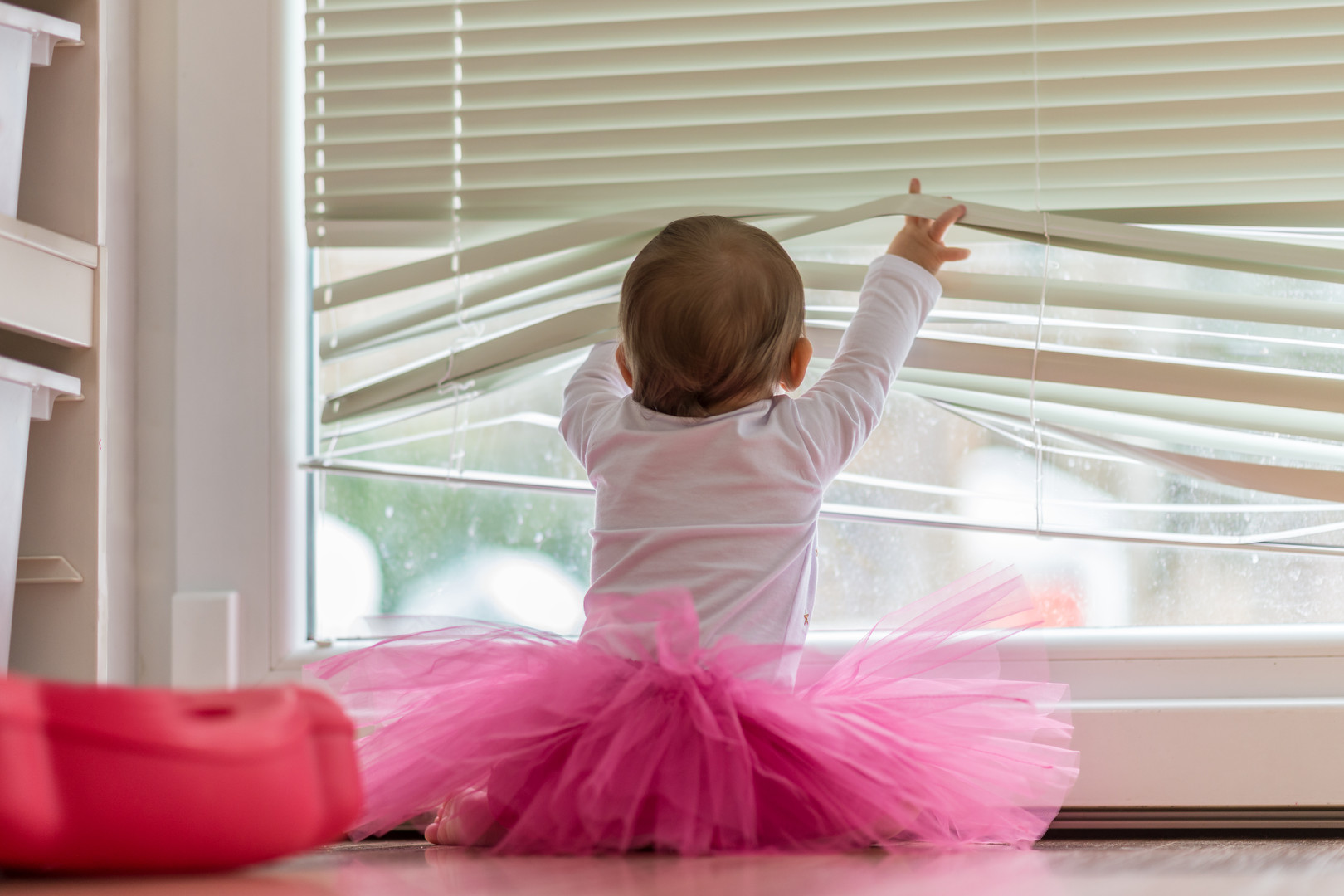 Cute little baby girl wearing a pink tut