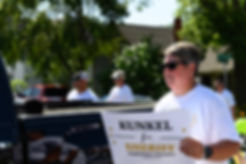 Woman holding sign at parade.jpg
