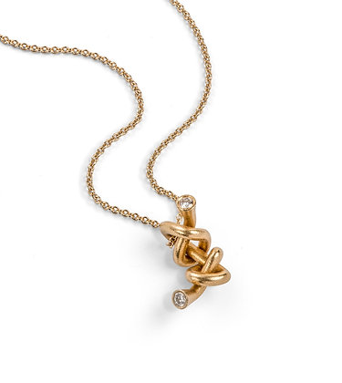 Simple gold and diamond knot necklace