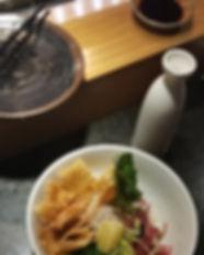 Ahi poke bowl with sake bottle LG croppe