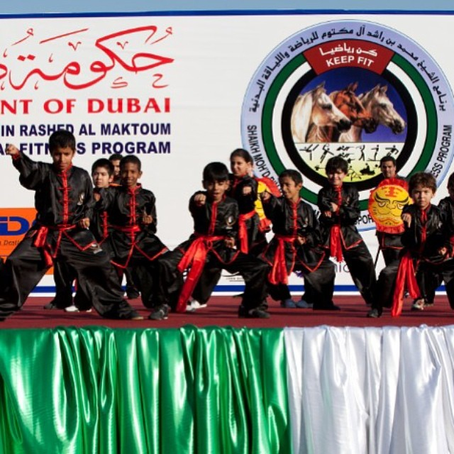 Golden Eagle Martial Arts students performing on stage for the Dubai Police and Sheikh Mohammed's Ke