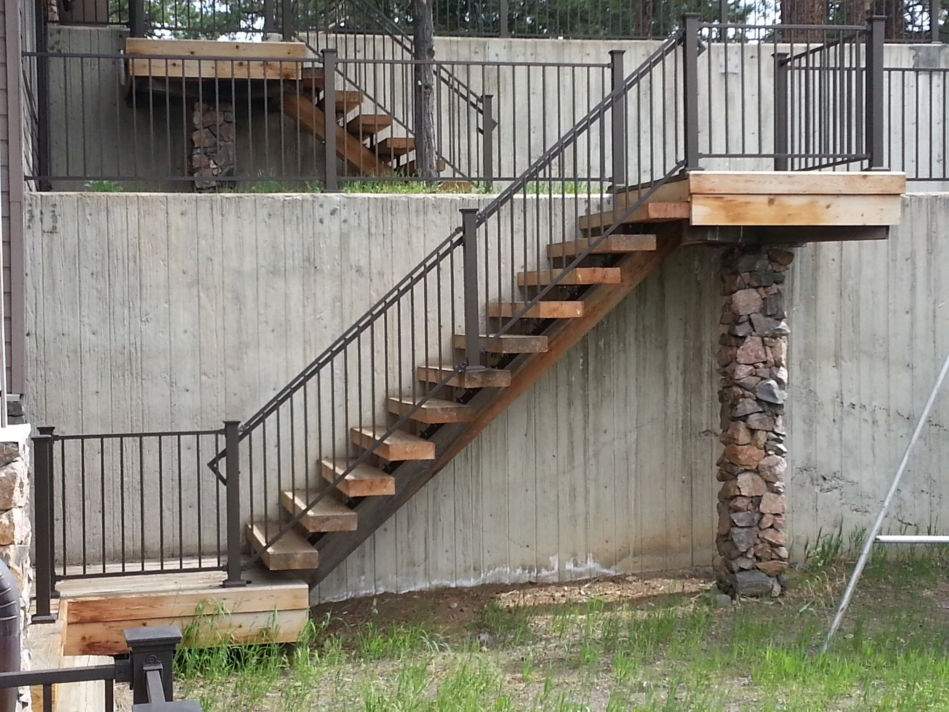 Custom Stairs and Stone Columns.