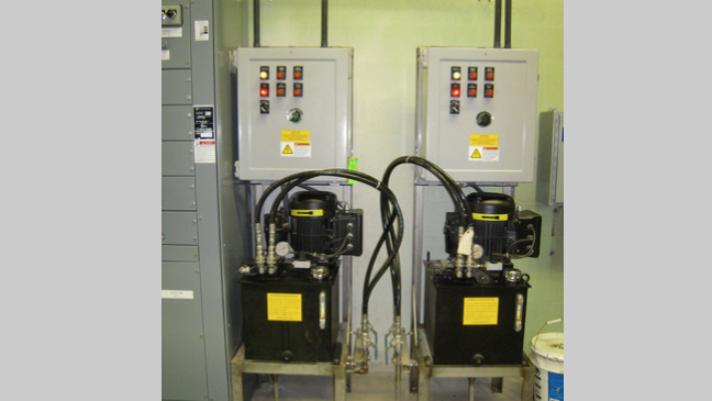 JWC hydraulic drives and control panels for Muffin Monster grinders