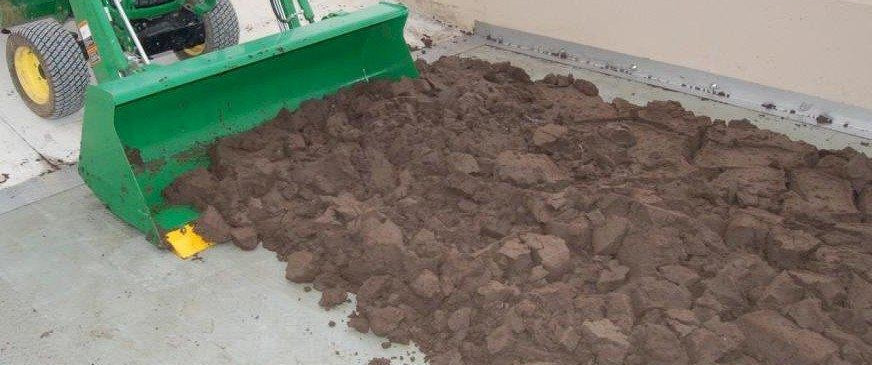 Gravity Flow Southwest – removal of dewatered sludge cake from filter bed