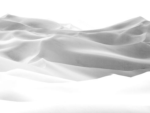 Grey scale image of sand dunes.
