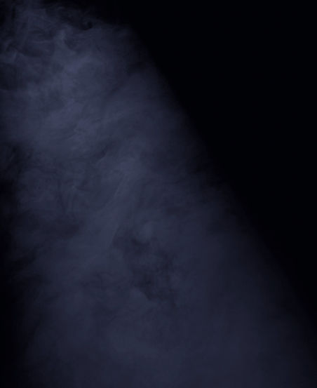 A man under the spotlight with smoke_edited_edited_edited.jpg