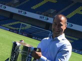 Jimmy with Millwall play off trophy