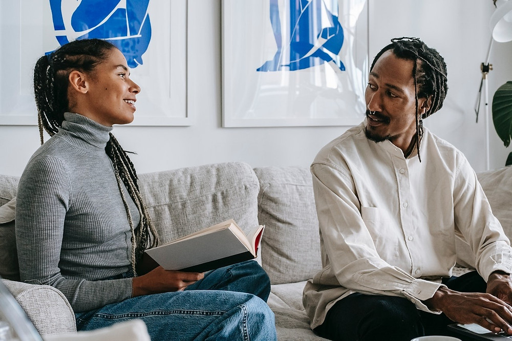 black couple talking and smiling