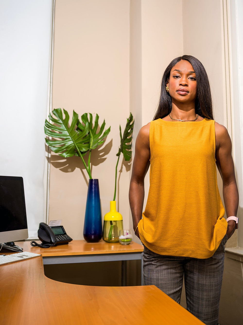 black woman standing in her home office