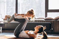Mother and daughter yoga at home.jpg