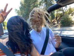 reyna and sophia enjoying a scenic jeep ride