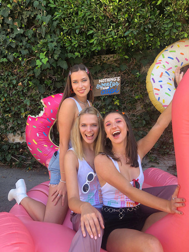 vienna, julianne, and taylor posing with the flamingo