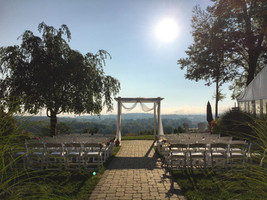 White Garden Chair Ceremony Setup