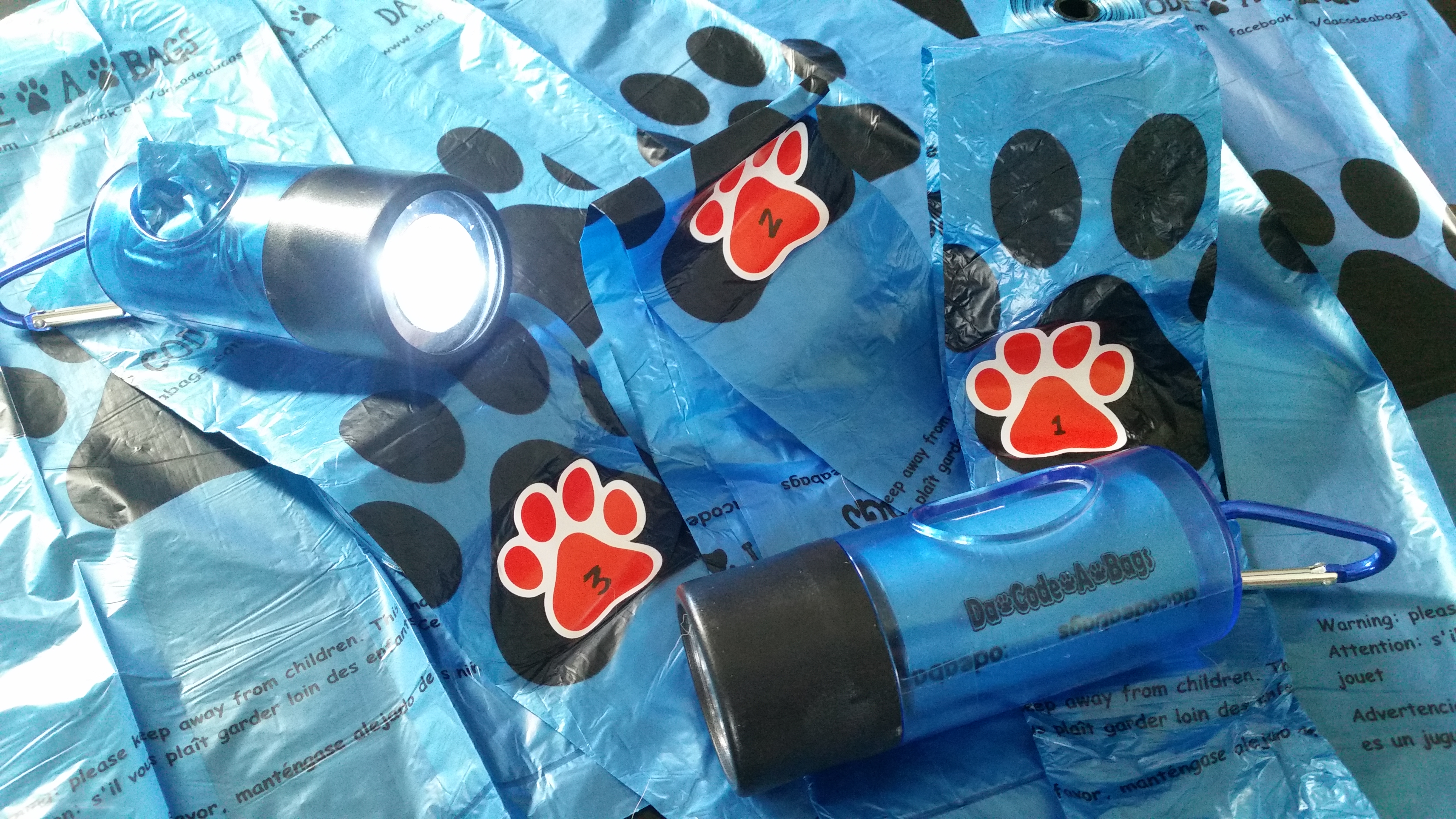 bags with flashlight dispenser