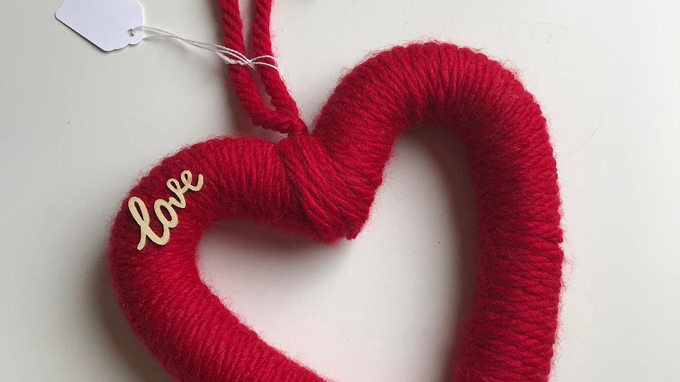 Red woollen heart wreath