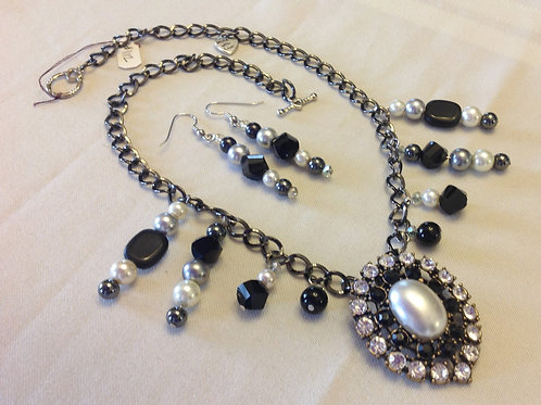 Item #1112 – black chain necklace with beaded drip accents and bold pendant.