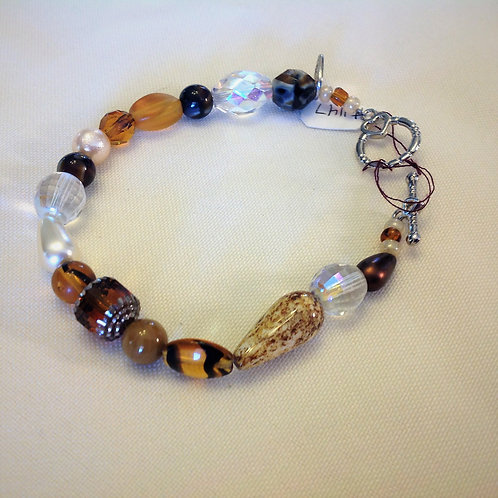 Item #1147 - Natural colors, browns, golds, tiger's eye plastic, crystals, glass
