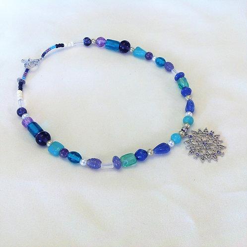 Item #616 - Greens, Purples, Crystals, Faux Pearls, Ceramic beads w/Snowflake