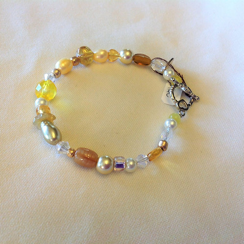 Item #1140 - Yellow/golds, plastic, crystals, glass and Faux Pearls- Bracelet