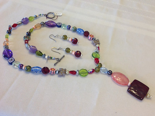 Item #907– Single Strand with stamped nickle, crystal & multi-colored beads