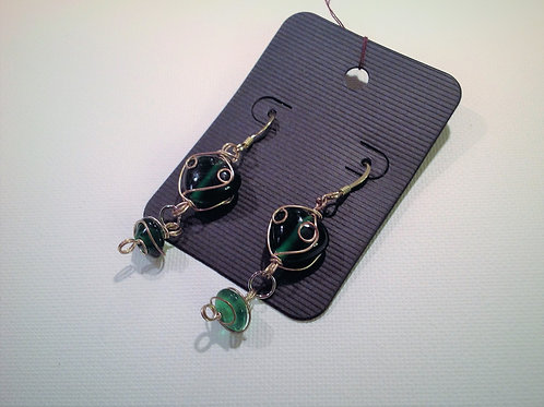 Item #811 –  Decorative green glass wire wrapped drop earrings