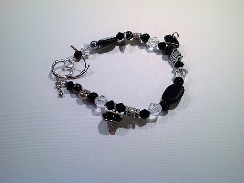 Item #503 –  Unique black, clear, glass, crystal and pressed nickle beads