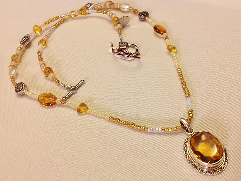 Item #338 - Single Strand, yellows, golds, with 12 carat Golden Citrine Pendant