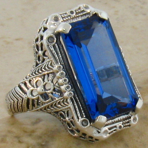 #137 - 9 Carat Deep Blue Topaz & .925 Sterling Silver Filigree Ring.