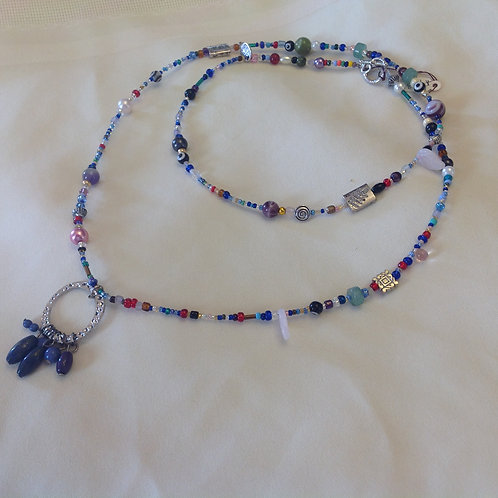#433 - Long Strand double wrap multi-colored, varied beads, stamped nickle drop