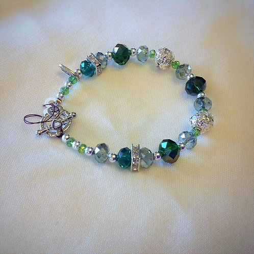 Item #504 –  Unique Nickle, Emerald Green, Clear Crystals & silver colored Beads