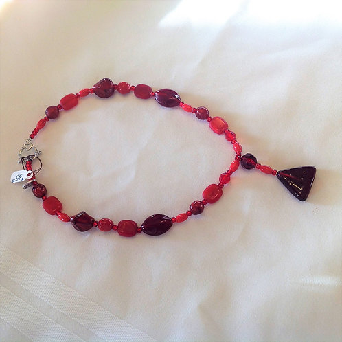 Item #611 – Single Strand of multi variations of Red Glass, Ceramic and Plastic