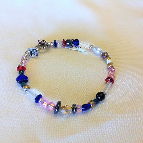 Item #1141 -Multi-colored, plastic,crystals, glass and Faux Pearls- Bracelet