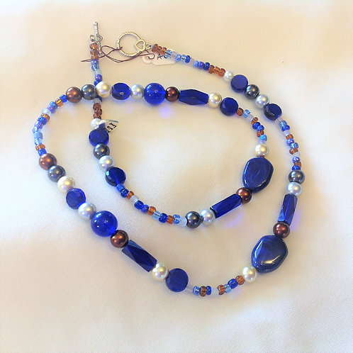 Item #633 - unique necklace in cobalt blues, coppers and faux pearls accents