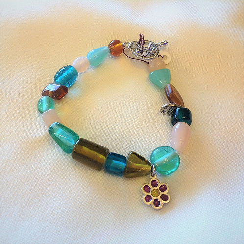 Item #1133 -Turquoise, Pinkand Amber colored Glass Stones with decorative flow