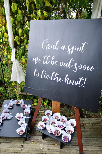 Grab a spot, we'll be out soon to tie the knot! ... sign