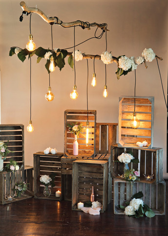 Retro Bulbs hanging from Branches with styled crates