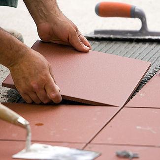 Handyman David laying tile