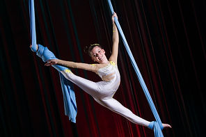 Circus artist acrobat performance on can