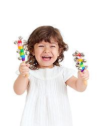 joyful kid girl playing with musical toy